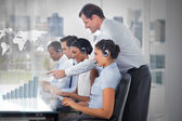 Call center employees at work on futuristic interfaces showing map and graph — Stock Photo