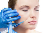 Content gorgeous model having botox injection on the cheek — Stock Photo