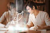 Happy college students analysing dna on digital interface — Stock Photo