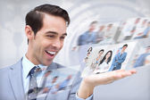 Joyful businessman looking at pictures — Foto Stock