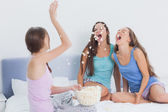 Friends messing around at slumber party — Stock Photo