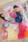 Cute girls making an outfit and looking at camera at sleepover — Stock Photo