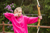 Concentrating blonde practicing archery — Stock Photo