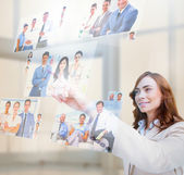 Pleased businesswoman selecting pictures — Stock Photo