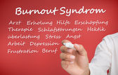 Hand writing different words about burnout syndrome in german — Stock Photo