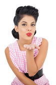 Pretty black hair model blowing a kiss to the camera — Stock Photo