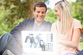 Smiling young couple watching photos together on digital interface — Stock Photo