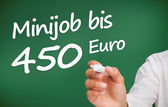 Hand writing with a white marker minijob bis 450 euro — Stock Photo