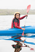 Happy woman rowing on lake — Stock Photo