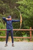 Brunette practicing archery — Stock Photo