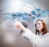 Smiling businesswoman pointing a picture whirl — Stock Photo