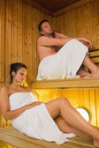 Content couple relaxing in a sauna — Stock Photo
