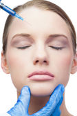 Peaceful attractive model having botox injection on the forehead — Stock Photo