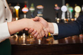 Close up on colleagues shaking hands — Stock Photo