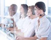 Pretty call center worker using futuristic holographic interface — Stock Photo
