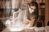 Serious mature student studying medicine on digital interface — Stock Photo