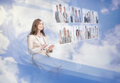Cheerful businesswoman using digital interface — Stock Photo
