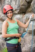 Pretty rock climber about to start her climb — Foto de Stock