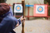 Brunette about to shoot arrow — Stock Photo