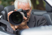 Paparazzi taking picture with his professional camera — Stock Photo