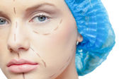 Close up on calm young patient with dotted lines on the face — Stock Photo