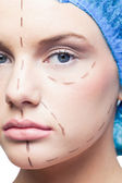 Close up on relaxed young patient with dotted lines on the face — Stock Photo