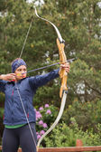 Focused brunette practicing archery — Stock Photo