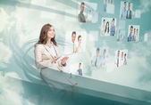 Smiling businesswoman using digital interface — Stock Photo