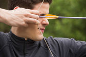 Concentrated man practicing archery — Stock Photo