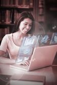 Cheerful student analysing graphs on her digital laptop — Stock Photo