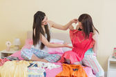 Girls looking at dresses at a sleepover — Stock Photo