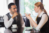 Business people talking over coffee — Stock Photo