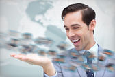 Joyful businessman looking at a picture whirl — Stock Photo