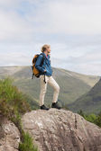 Woman standing on rock admiring the view — Stock Photo
