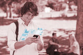 Happy student using his digital smartphone — Stock Photo