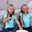 Sisters watching television — Stock Video