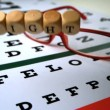 Dice spelling out sight falling onto eye test next to glasses — Vídeo Stock