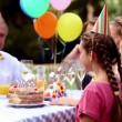Stock Video: Family celebrating the birthday of a girl