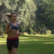 Stock Video: Athletic womin sportswear running