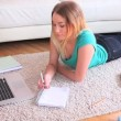 Pretty young blonde studying on her laptop — Stock Video