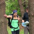 Fit couple exploring a wooded area reading a map — Stock Video