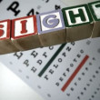 Stock Video: Blocks spelling sight falling on eye test