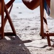 Lovely couple sitting on the beach — Stock Video #31529113