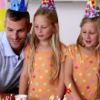 Twin sisters blowing out candles — Stock Video