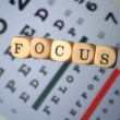 Dice spelling out focus falling on eye test — Stockvideo