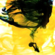 Vídeo Stock: Yellow ink swirling into water whirlpool