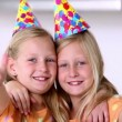 Twin sisters with thumbs up at birthday party — Stock Video