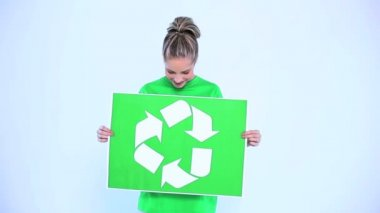 Blond woman holding a banner for the environment — Stock Video