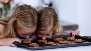 Daughter smelling cookies — Stock Video