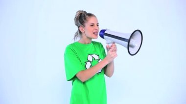 Attractive environmental activist screaming in a megaphone — Stock Video